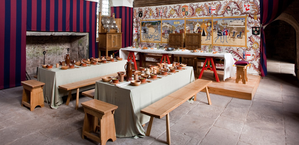 The Great Hall at Tretower Court, set for a dinner in c.1465