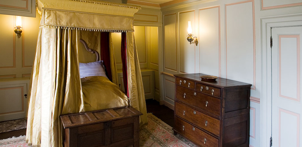 Our restored Georgian Bedchamber at Nantclwyd House (Georgian Period), with bed furnished in yellow silk